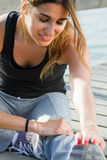 Young woman doing push ups near the sea Royalty Free Stock Photography