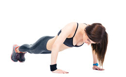 Young woman doing push ups Stock Photos