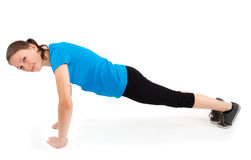 Young woman doing push ups royalty free stock photography
