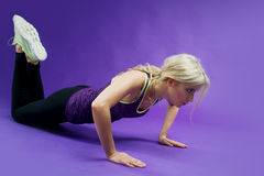 Young Woman Doing Push-Ups workout fitness in studio Stock Images