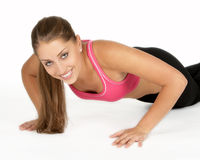 Young Woman Doing Pushup. Beautiful Young Woman Doing Pushup Stock Image