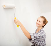 Young woman doing repairs Royalty Free Stock Photos
