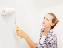 Young woman doing repairs Stock Photos