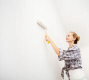 Young woman doing repairs Royalty Free Stock Image