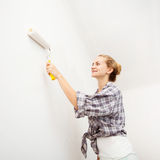 Young woman doing repairs Royalty Free Stock Photo