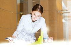 Young woman doing research Royalty Free Stock Image