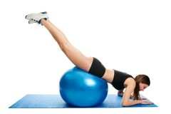Young woman doing roll-out on the fitness ball Royalty Free Stock Images