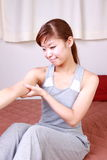Young woman doing self arm massage Royalty Free Stock Image