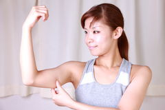 Young woman doing self arm massage Royalty Free Stock Photos