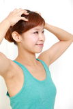 Young woman doing self head massage Royalty Free Stock Photo