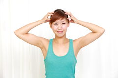 Young woman doing self head massage Stock Photography