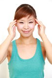 Young woman doing self head massage Stock Image