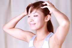 Young woman doing self head massage royalty free stock photography