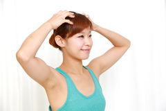 Young woman doing self head massage Royalty Free Stock Image