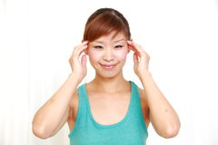 Young woman doing self head massage Stock Photos