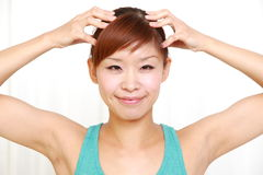 Young woman doing self head massage Royalty Free Stock Images