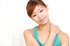 Young woman doing self massage Royalty Free Stock Photos