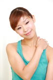 Young woman doing self massage Royalty Free Stock Images