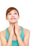 Young woman doing self neck massage Royalty Free Stock Photography
