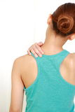 Young woman doing self shoulder massage Royalty Free Stock Images
