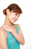 Young woman doing self shoulder massage Stock Images
