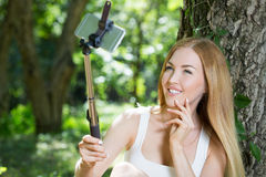 Young woman doing selfie Royalty Free Stock Images