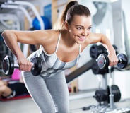 Young woman doing shoulder exercise Stock Image