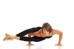 Young woman doing Side Crow Pose Royalty Free Stock Photos