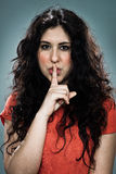Young Woman Doing Silence Sign Royalty Free Stock Image