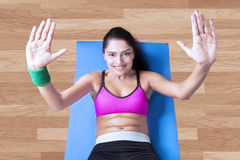 Young woman doing sit up on mattress Royalty Free Stock Photography