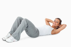 Young woman doing sit ups Stock Image