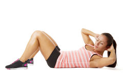 Young woman doing sit-ups Royalty Free Stock Images