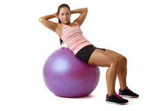 Young woman doing situps on ball Stock Photography