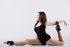 Young woman doing splits Stock Images