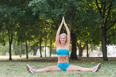 Young woman doing sport exercise in the park Royalty Free Stock Image