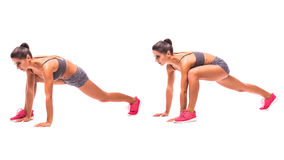 Young woman doing sport exercise. Plank Lunge with Push-up.Young woman doing sport exercise Royalty Free Stock Images