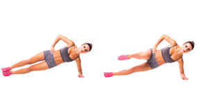Young woman doing sport exercise. Side Plank Dip Young woman doing sport exercise Stock Image