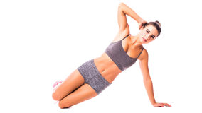 Young woman doing sport exercise. Stock Photo