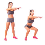 Young woman doing sport exercise. Sit Squats. Young woman doing sport exercise Stock Images