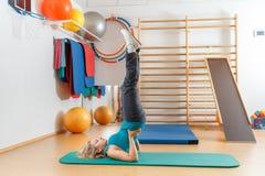 Young woman doing sport exercises Stock Photos