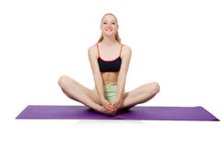 Young woman doing sport exercises isolated Royalty Free Stock Image