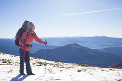 Young woman doing sport in the mountains. Stock Photos