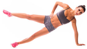 Young woman doing sport. Side Plank with Raised Leg young woman doing exercise Stock Photos