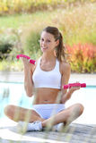 Young woman doing sports around swimming pool Royalty Free Stock Image