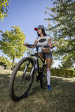 Young woman doing sports on the bike. Morning training Royalty Free Stock Photo