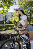 Young woman doing sports on the bike. Morning training Royalty Free Stock Image