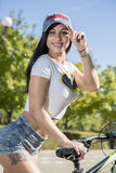 Young woman doing sports on the bike. Morning training Stock Image