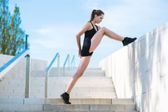 Young woman doing sports exercises in the park. Beautiful young woman doing sports exercises in the park Stock Images