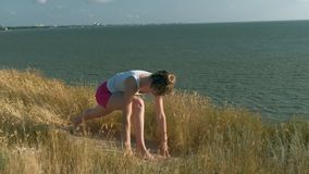 Young woman doing sports outdoors, yoga stock video