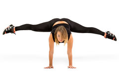 Young woman doing standing split isolated Stock Images